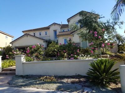 guest house is on the right side facing the flowers.