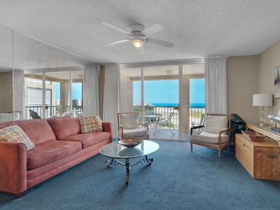 Photo for 4th Floor Airy, open bay view condo, beach setup & close to everything!