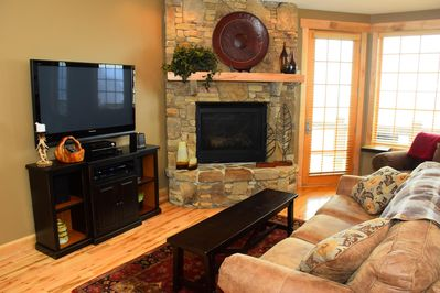 Living room with stone fireplace.  Steps to the main level back deck.