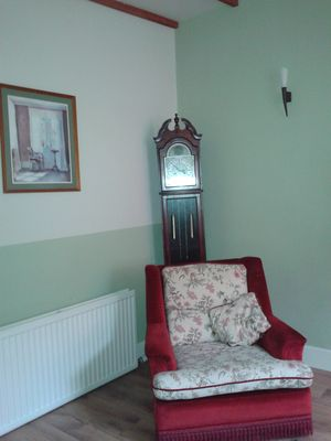 """The lounge even boasts this charming """"grandfather clock"""" feature"""