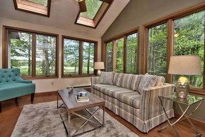 Sunroom with views of the lake