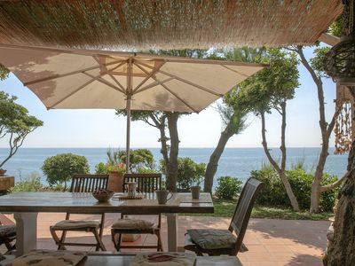 Photo for Seaside villa with terraces, garden and lawns around direct access to the sea