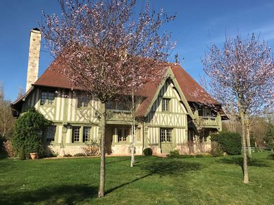 Photo for Beautiful and spacious manor typical Pays d'Auge with heated pool near Cabourg