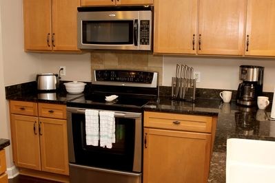 Kitchen with updated appliances and granite countertops
