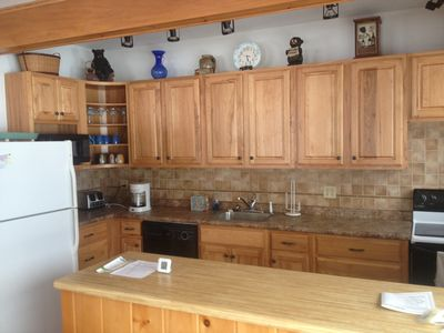 Updated Kitchen:  electric oven/stove, dishwasher and all small appliances.