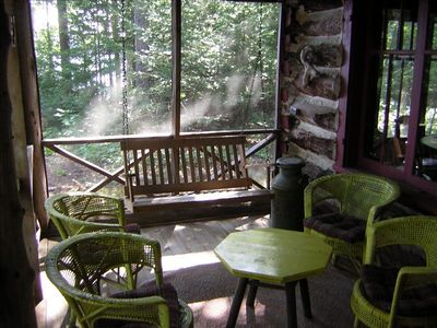 The Front Porch in the morning - sit with coffee; swing; look at the lake.