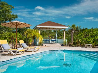 Photo for Columbus Cottage, 5 min walk Grace Bay, Good Pool, Private Garden; sleeps 5.