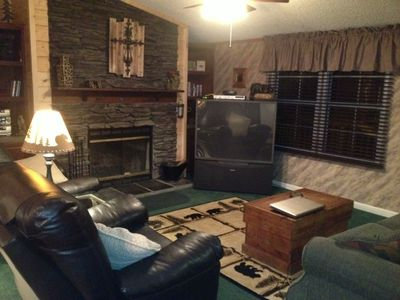 Relax in one of the two recliners while sitting by the fire watching TV