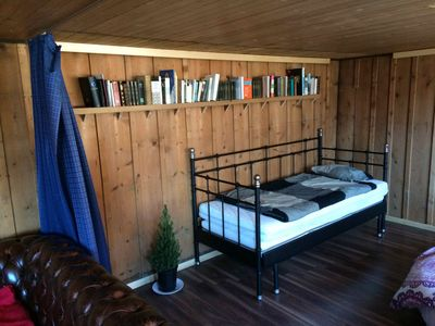 Comfortable Beds and Library with Must Reads.