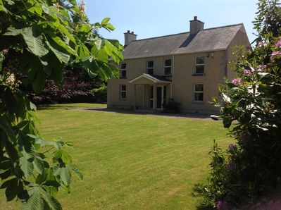 Extensive, manicured lawn and private garden to the front