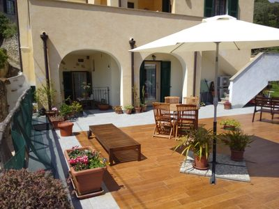 Photo for SUNFLOWER HOUSE - BETWEEN SEA AND COUNTRYSIDE WITH TERRACE AND GARDEN