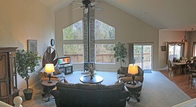 Elegant Great Room with 18 foot cathedral ceiling and gas fireplace.