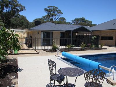Photo for Sunrise Retreat -beautiful new holiday home with shared pool