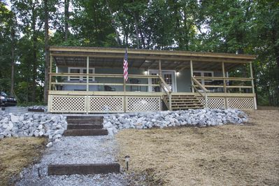 Full 10' x 40' deck with hot tub and dining area