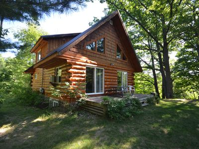 Photo for Cozy, log home in Traverse City. Fire pit, pet friendly, fireplaces.
