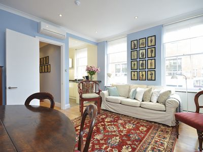 Photo for Enjoy this calming Mayfair retreat featuring fine furnishings and AC.