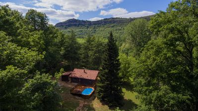 Photo for Chalet near river in a wooded park & heated swimming pool