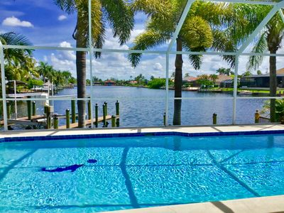 Photo for Awesome water views, Sunrises & Sunsets - 10 min. to Beach - Private heated Pool