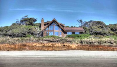A lovely private home on a bluff above a beautiful sandy beach.