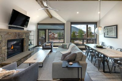 Great room with fireplace and ski slope views