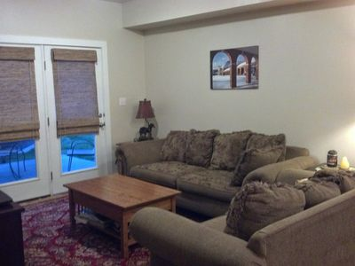 Plenty of comfortable seating with french door access to patio
