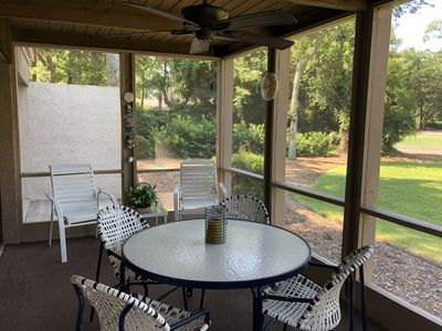 SCREENED PORCH  WITH FAN OVERLOOKS THE 9TH TEE OF THE HARBOUR TOWN GOLF COURSE.