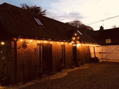The lodge at night, private driveway