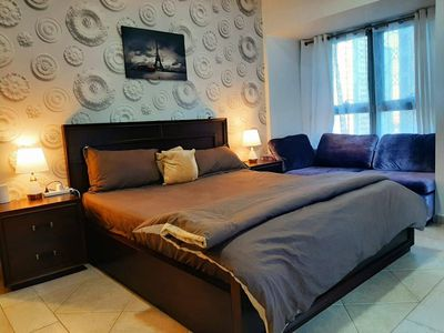 master bedroom with king bed and sofa bed
