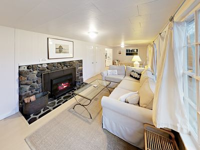Unit 1: Living Area - In the back unit, you'll find a vintage cabin with a welcoming feel.