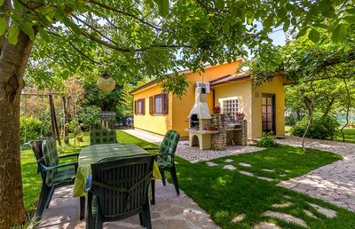 Photo for Holiday home for sole use with bedroom, bathroom, kitchen, air conditioning, large garden with barbecue and only 700 meters to the sandy beach