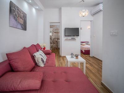 Photo for Lovely apartment for 4 people with A/C, WIFI, TV, pets allowed and parking
