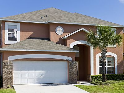 Photo for Inviting 6 bedroom Kissimmee villa features 4 king masters, a private pool and spa