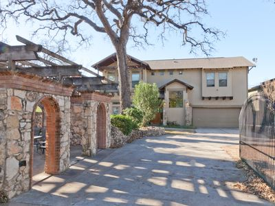 Beautiful stone and stucco home with outdoor seating and fireplace. Very private