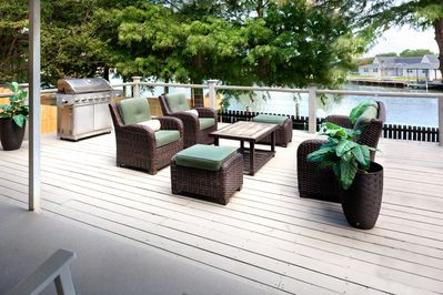 Large deck overlooking the water and boat dock
