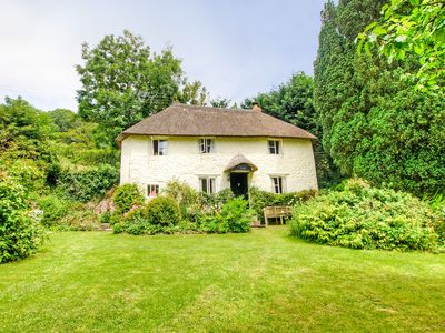 Photo for Yew Tree Cottage - A delightful Devon thatched Cottage with woodturning stove