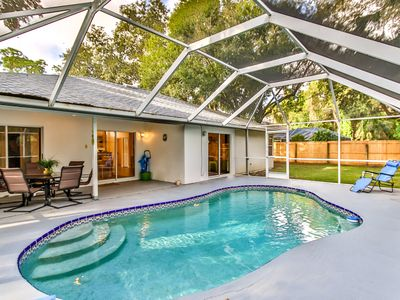 Photo for Tropical Getaway. 3/2 , heated pool, 15 min. from beach.  Near Indian River