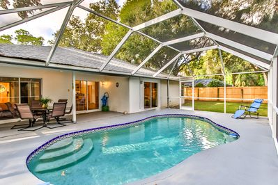 Heated pool, furnished lanai and sliding glass doors for easy access & enjoyment