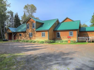 Photo for Lake front lodge, unobstructed view of lake, private sandy beach