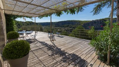 Photo for Charming cottage, jacuzzi, stunning 180° view on the Ardèche river