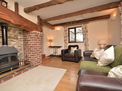 Hard flooring and exposed beams throughout