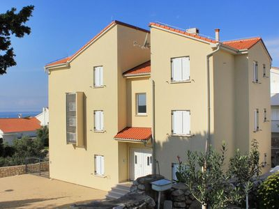 Photo for Two bedroom apartment with terrace and sea view Novalja, Pag (A-9373-a)