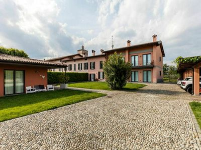 Photo for Peaceful Apartment amidst Lombardy Vineyards in Iseo