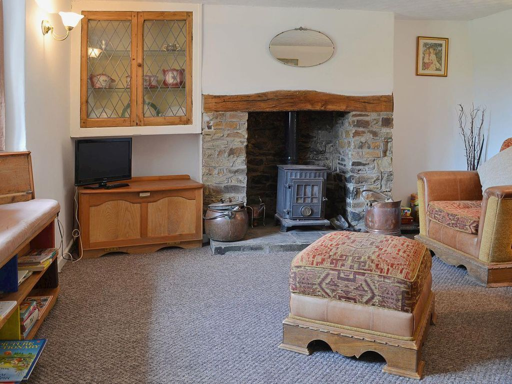 chilsworthy cottage rental cosy living room with woodburner - Slate House Design