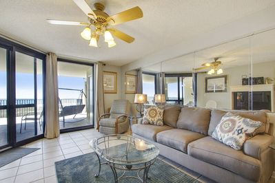 The spacious living room has plenty of comfortable seating and access to the Private Balcony.
