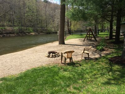 Down Stream View of River with Riverside Fire Pit on the Stone Beach Landing