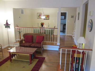 Into the living room, looking back toward the dining area and kitchen.