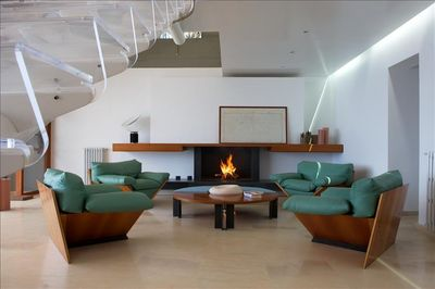 Living Room offers a Fireplace and Repose