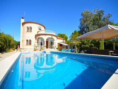 Photo for Set in pretty Mediterranean gardens, large swimming pool, air-con & FREE WIFI
