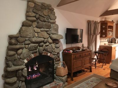 Authentic custom river Rock fireplace gas turn on