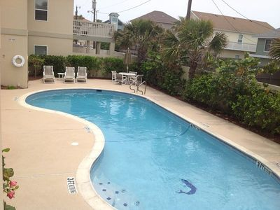 Photo for Second floor condo less than 1/4 block to the beach. Sleeps 10, 3 bedrooms, 2 baths. Shared Pool